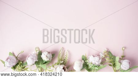 Flowers On A Pink Background Arranged In A Line From The Bottom.