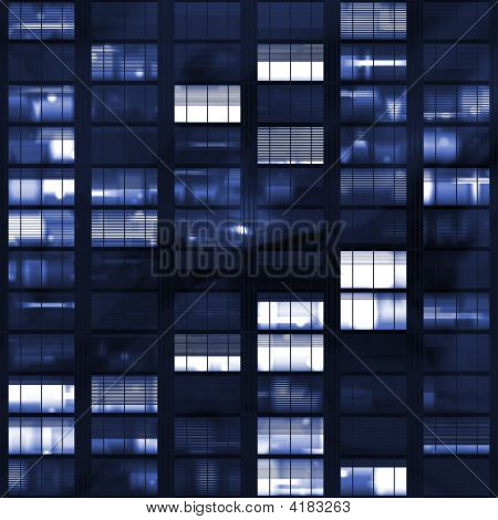 Voyeuring Office Building After Dark In Blue Tones poster
