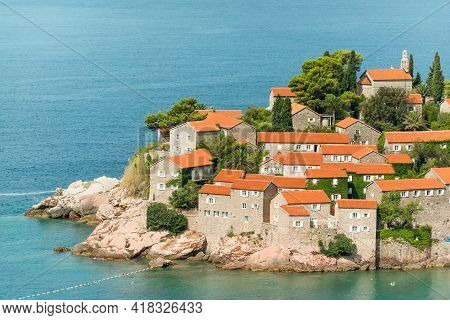 Red Tiled Roofs Of Famous Sveti Stefan Island On Adriatic Coast, Montenegro
