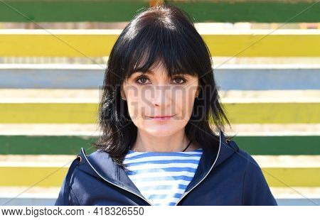 Portrait Of 45 Y.o. Russian Woman Smiling And Looking At Camera