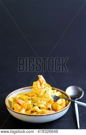 Shrimp Pasta.shrimps On A Fork With Pasta.shrimp Noodles.pasta With Creamy Sauce And Pesto Sauce.shr