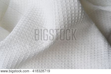 Fresh Kitchen Towel With Texture Is Casually Tossed And Forms An Abstract Shape. Background From Tex