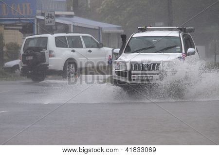 Brisbane, Australia - January 27 : Four Wheel Drives Crossing Flooded Roads During Tropical Cyclone