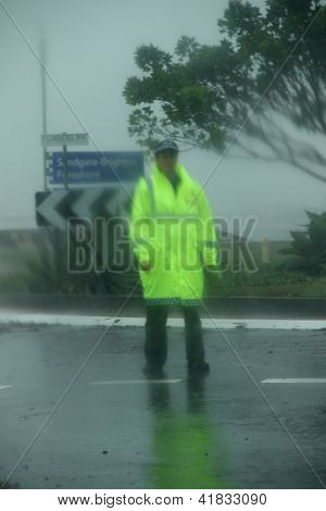 Brisbane, Australia - January 27 : Unidentified Police Woman Guards Flooded Road During Ex Tropical
