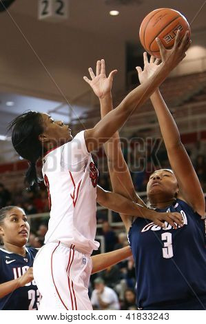 JAMAICA-FEB 2: St. John's Red Storm guard Aliyyah Handford (3) is defended by Connecticut Huskies forward Morgan Tuck (3) defends at Carnesecca Arena on February 2, 2013 in Jamaica, New York.