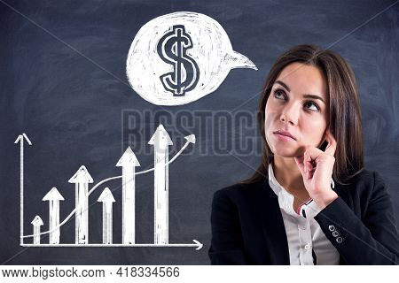 Sucessful Investing Concept With Pensive Trader And Handwritten White Financial Chart Graph And Doll