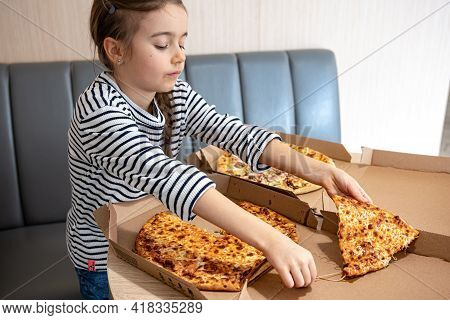 Little Girl Eats Appetizing Cheese Pizza For Lunch. Delicious Cheesy Pizza.