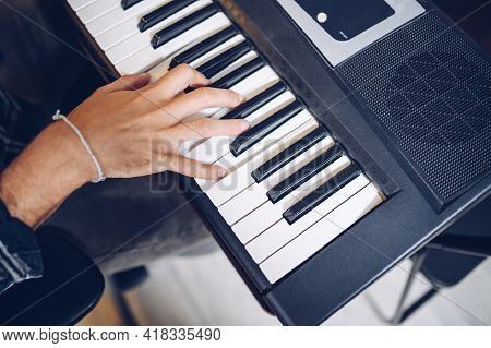 Pianist's Hand On Electronic Piano Keyboard, View From Above.