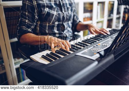Professional Pianist Playing Piano At Home. Enjoying Music