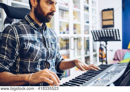 Very Concentrated Pianist Practices With His Piano In His Home Studio.enjoying Music
