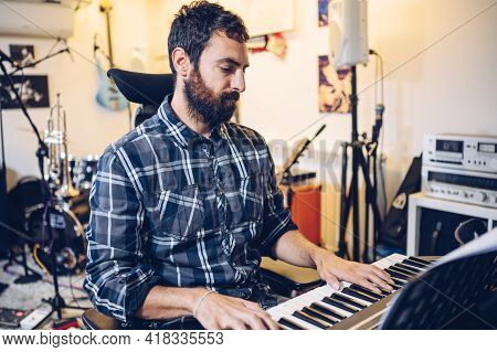 Professional Musician Playing The Piano In A Rehearsal Room.enjoying Music.
