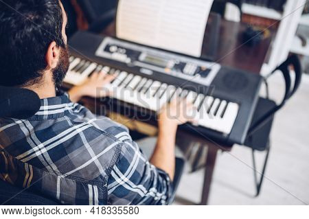 Amateur Pianist Playing The Piano At Home.enjoying The Music