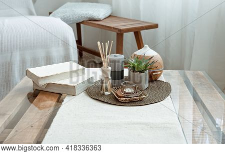 Composition With Incense Sticks, Diffuser, Candles And Book On The Table In The Interior Of The Room