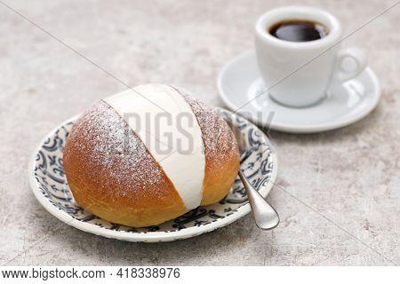 homemade Maritozzo is italian roman breakfast sweet that whipped cream sandwished between brioche.