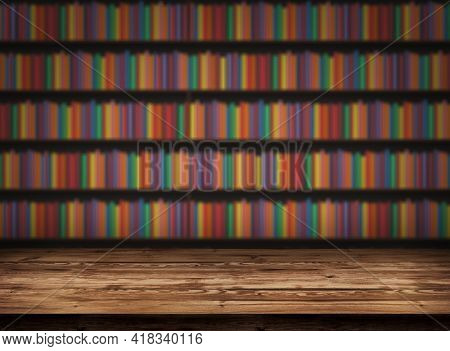 Wooden Table On The Background Of A Bookshelf With Book. Blurred Background With Bookshelves. Table