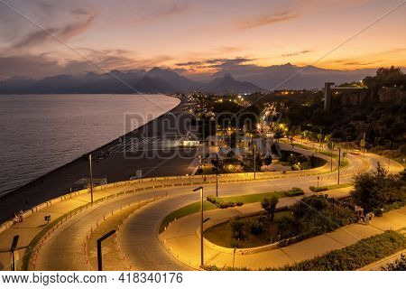Top view at Konyaalti beach, mountains and the Mediterranean sea at twilight in Antalya, Turkey