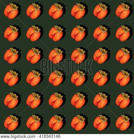 Seamless Rhythmic Pattern Made Of One Ugly Orange Persimmon On Dark Green Background With Hard Shado
