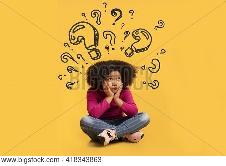 Confused Black Girl With Question Marks Above Her Head Thinking About Something, Unable To Find Solu