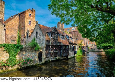 Canal with old houses in Bruge, Beligum