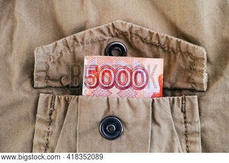 A Five Thousand Ruble Bill In The Pocket Of A Beige Jacket. Close-up
