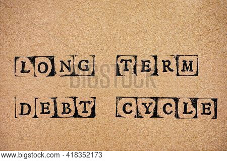 Cardboard With Words Long Term Debt Cycle Made By Black Alphabet Stamps.