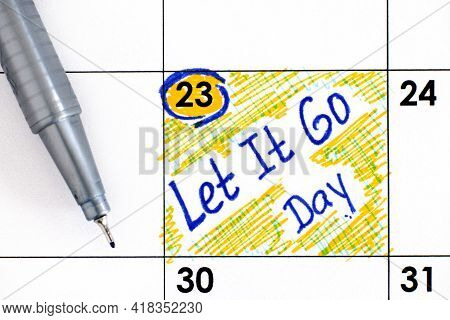 Reminder Let It Go Day In Calendar With Pen. June 23.