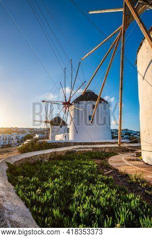 Traditional greek windmills on Mykonos island at sunrise, Cyclades, Greece
