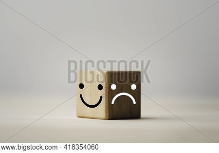 Smiley Face On Bright Side And Sadness On Dark Side Of Wooden Cube Block , Emotion Selection And Min