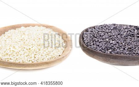 Seeds Of Black And White Sesame On A Wwoden Spoon.unpeeled Sesame Seeds. Healthy Food. Nature Vitami