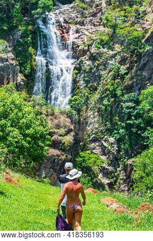 São Roque De Minas - Mg, Brazil - December 15, 2020: Couple Of Tourists Walking To Capão Forro Water