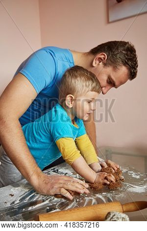 Fathers Day Concept. Father And Son Together Bakes Cookies At Home. Homemade Baking. Family Time At