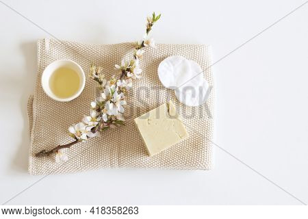 Closeup Of Hand Made Herbal Soap And Almond Oil. Almond Twigs White Table Background. Spa Concept. S