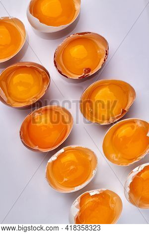 Top View Set Of Eggshells With Yolk.