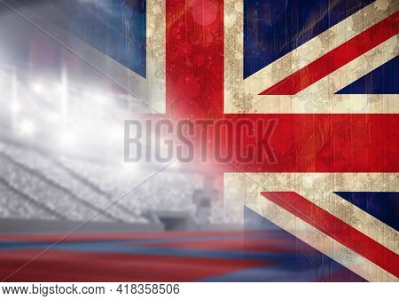 Digital composite image of faded great britain flag against sports stadium. patriotism and sports concept