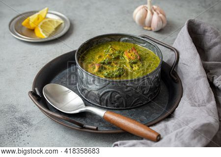 Traditional Vegetarian Indian Punjabi Food Palak Paneer With Spinach And Cheese In Vintage Metal Bow