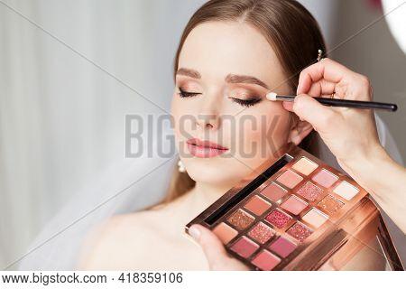Wedding Make Up Artist Making Professional Bride Makeup. Bridal Eyeshadow Palette. Wedding Cosmetics