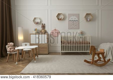 Modern Baby Room Interior With Stylish Furniture And Toys