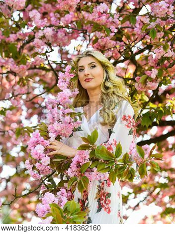 Harmony And Female Energy. Spring Blossoming Tree. Spring Symbol. Girl Enjoy Sakura In Garden. Reaso