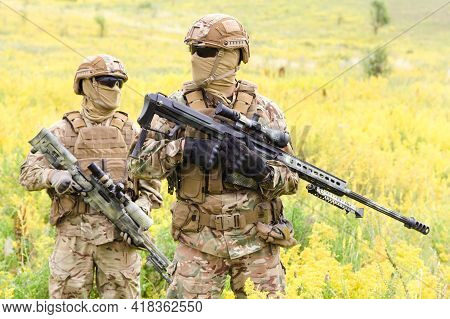 Two Equipped And Armed Soldiers With Rifles In The Blooming Field, Team Snipers Member Of Ranger Squ