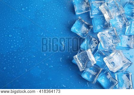 Ice Cubes With Water Drops On Light Blue Background, Flat Lay. Space For Text