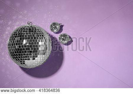 Bright Shiny Disco Balls On Violet Background, Flat Lay. Space For Text