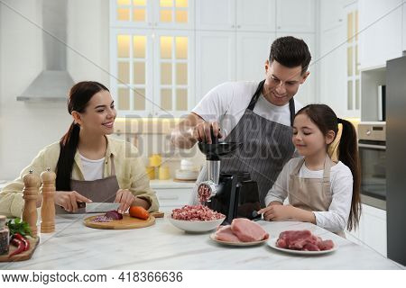 Happy Family Making Dinner Together In Kitchen, Father And Daughter Using Modern Meat Grinder While
