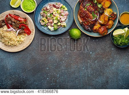 Assorted Dishes Of Peruvian Cuisine: Beef And Peppers Lomo Saltado, Peruvian Ceviche With Fish And S