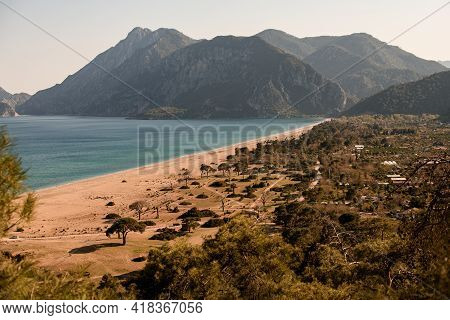 Magnificent View Of Line Of Sea Coast Against Background Of Mountains