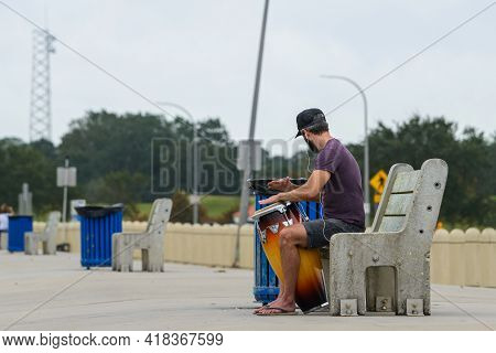 New Orleans, La - October 9: Man Practices On Conga Drum On Lakefront On October 9, 2020 In New Orle