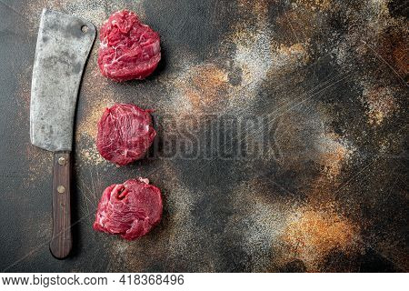 Raw Fresh Marbled Meat Steak Filet Mignon Set, And Old Butcher Cleaver Knife, On Old Dark Rustic Bac