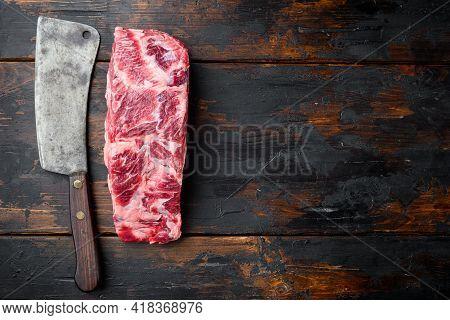 Freshly Cut Boneless Ribeye Big Piece Cut Set, With Old Butcher Cleaver Knife, On Old Dark  Wooden T