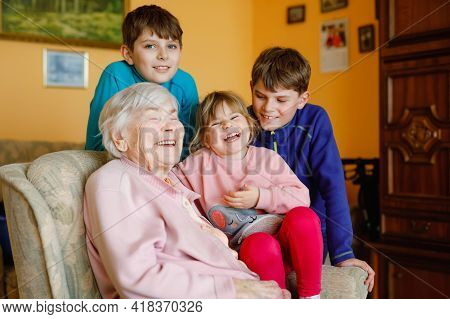 Great-grandmother With Three Children, Siblings. Family Of Four, Two Boys And Little Toddler Girl. H