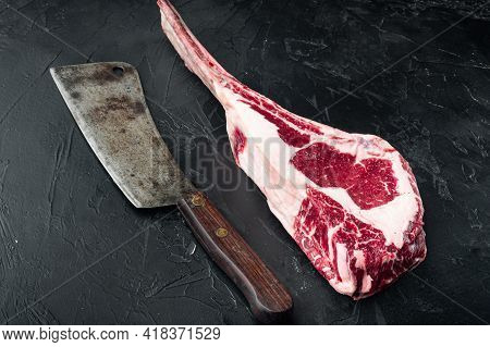 Raw Fresh Tomahawk Black Angus Prime Beef Chop Steak Set, And Old Butcher Cleaver Knife, On Black St