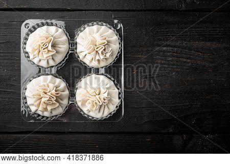 Uncooked Baozi Chinese Dumplings. Azian Dumplings Set, In Plastic Tray, On Black Wooden Table Backgr